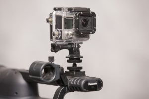 GoPro mounted on top of a Panasonic video camera via the use of a hot shoe adapter.