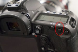 The AE Lock button on the back of most Canon SLR cameras