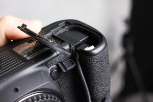 Camera Coupler fully seated in the camera's battery housing